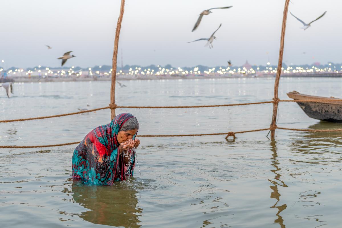Kumbh Mela - Woman drinking