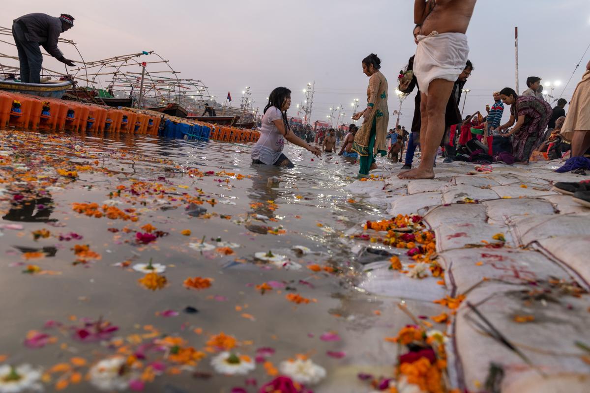 Kumbh Mela - Woman bathing